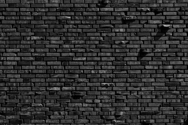 Oude zwarte bakstenen muur achtergrond