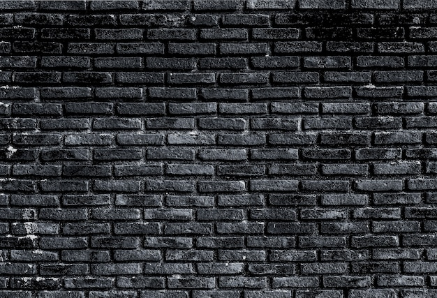 Oude zwarte bakstenen muur close-up