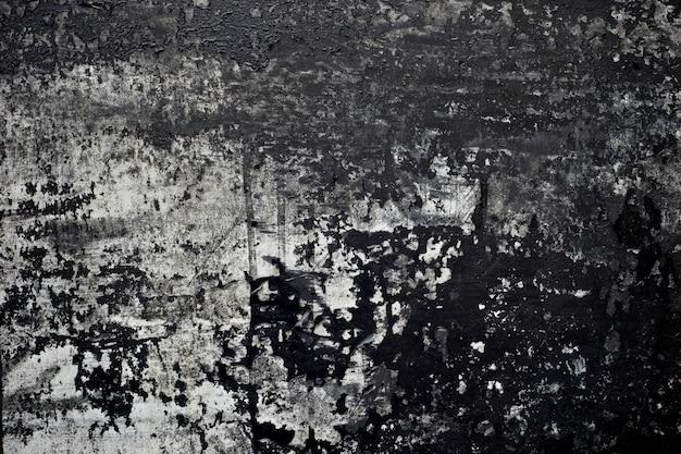 Oude zwarte verftextuurschil van concrete muurachtergrond