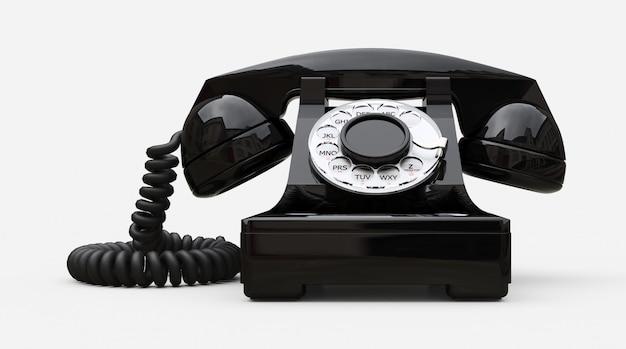 Oude zwarte wijzerplaattelefoon op een witte achtergrond