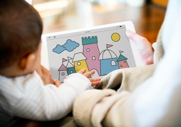 Ouders gebruiken het delen van digitale apparaten met hun kinderen.