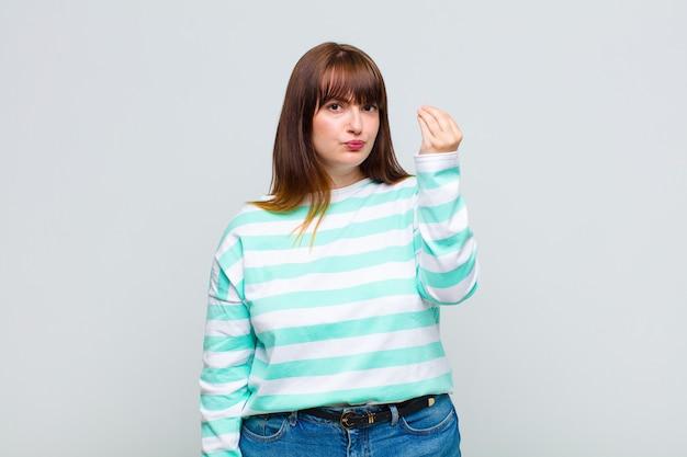 Overgewicht vrouw capice of geld gebaar maken