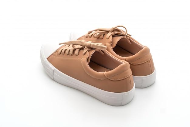 Paar bruine sneakers