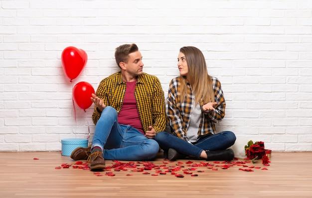 Paar in valentijnskaartdag bij binnen het hebben van twijfels