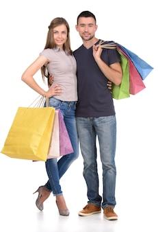Paar met het winkelen zakken, op wit wordt geïsoleerd dat