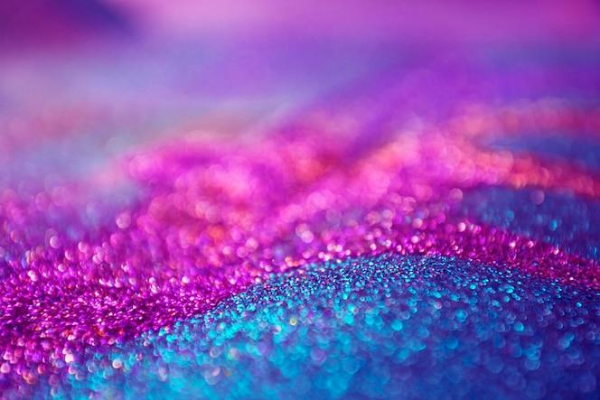 Paars en roze glitter bokeh lichten achtergrond