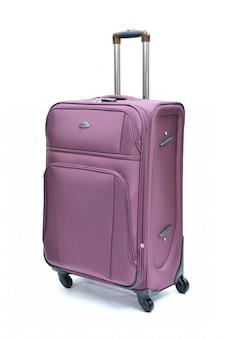 Paars van moderne grote koffer op een wit
