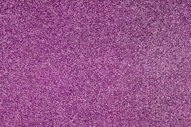 Paarse achtergrond op volledig scherm met horizontale textuur van glitters