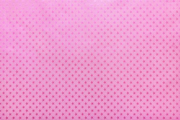 Paarse achtergrond van metaalfoliepapier met een sterrenpatroon