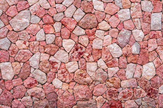 Paarse en roze marmeren stenen muur textuur achtergrond. close-up oppervlak grunge steen textuur, metselwerk rock oud patroon schoon raster ongelijke bakstenen ontwerp stapel.