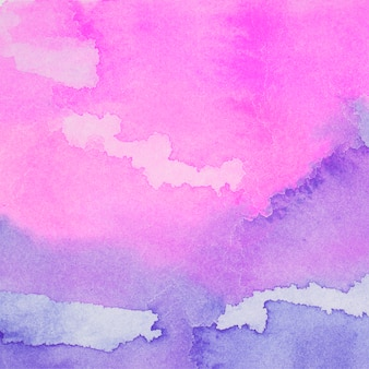 Paarse en roze mix van verven op papier