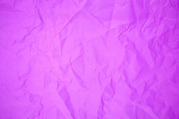 Paarse verfrommeld papier achtergrondstructuur