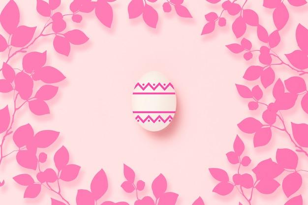 Paasei op een roze achtergrond.