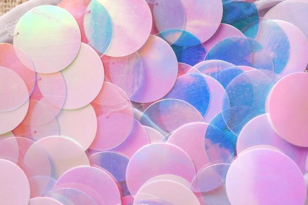 Paillettenachtergrond in blauwe en roze kleuren