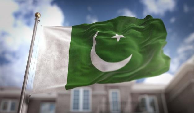 Pakistan vlag 3d-rendering op de blauwe hemel gebouw achtergrond