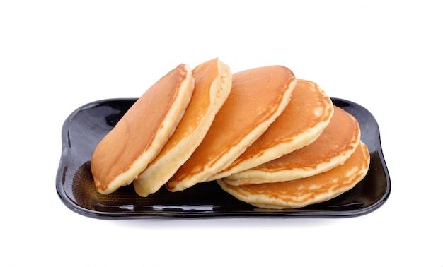 Pannenkoeken op plaat geïsoleerd