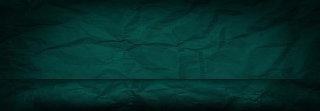 Panoramische groene verfrommeld papier studio achtergrond