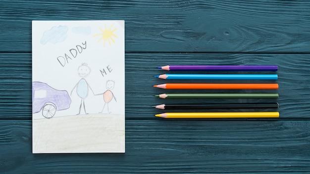 Papa en me inschrijving met kleurrijke potloden