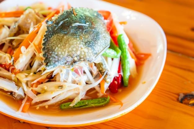 Papajasalade met blauwe krab