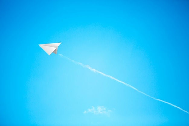 Paper planes in blue sky