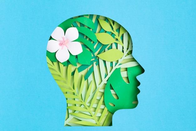 Papercut hoofd met groene bladeren aan de binnenkant