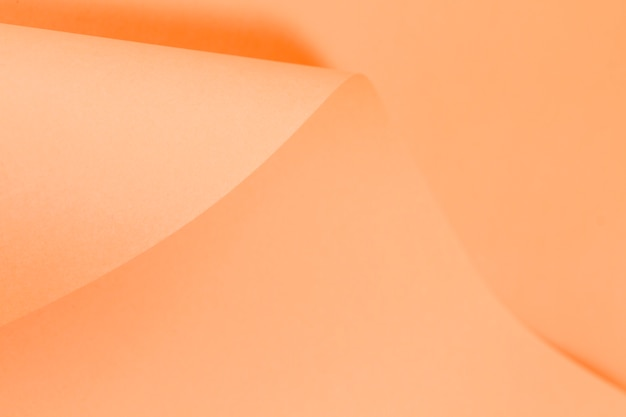 Papier gekrulde oranje paginatextuur