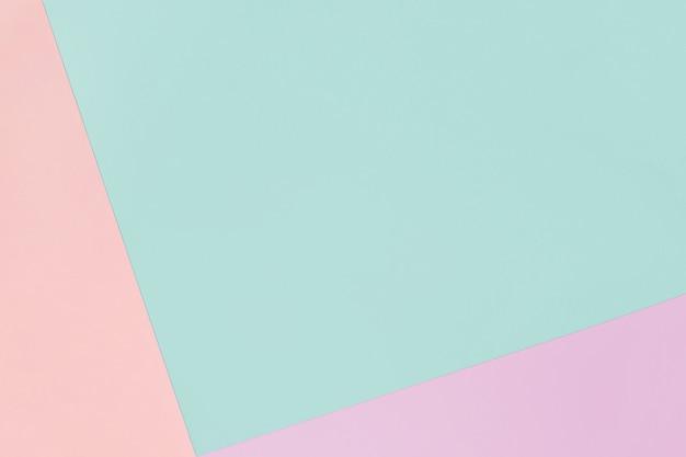 Papier geometrische pastel achtergrond in roze en blauwe kleuren met kopie ruimte.