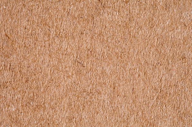 Papier is ruw oud oranje, achtergrondstructuur, close-up macroweergave