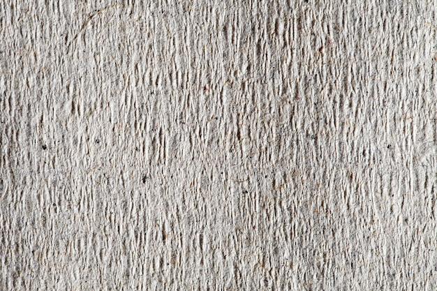Papier ruw grijs oud, achtergrondstructuur, close-up macroweergave