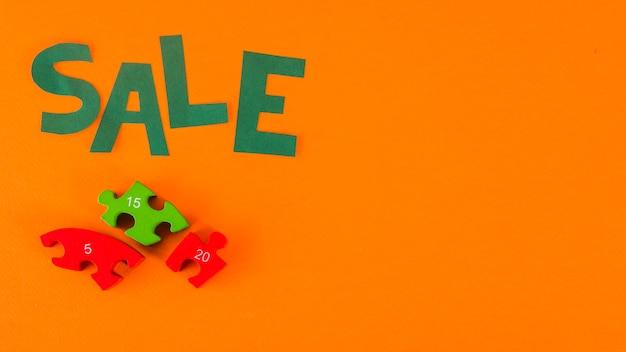 Papier verkoop belettering op oranje achtergrond