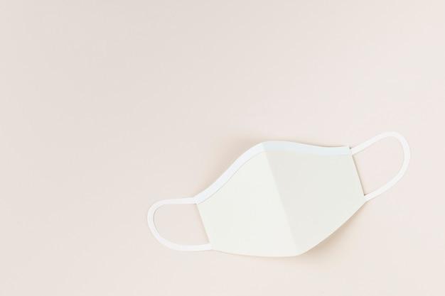 Papieren ambachtelijk chirurgisch masker op een lichtbruine achtergrondillustratie