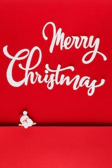 Papieren kerst met letters en santa