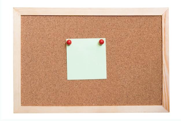 Papieren notities kleverig in cork board. notitiepapieren op een oud houten frame.