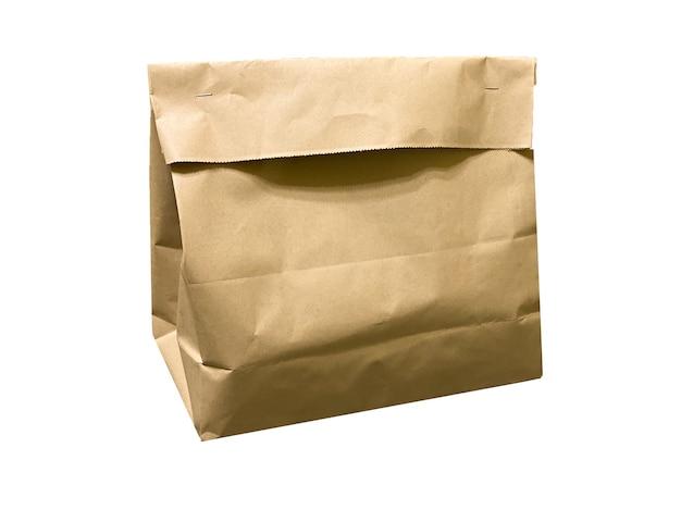 Papieren zak voor voedselbezorging van restaurants of producten uit de supermarkt geïsoleerd op een witte achtergrond. voedselbezorgingssjabloon met plaats voor tekst.
