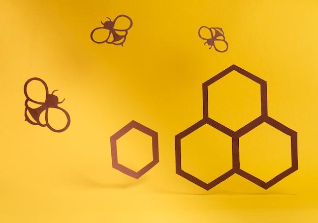 Papierkunst met papiersnijder bijen en honingraten gezond snoep biologisch voedselconcept