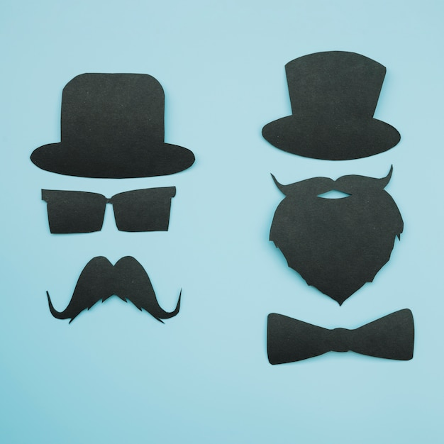 Papieruitsparingen van heren in hoeden
