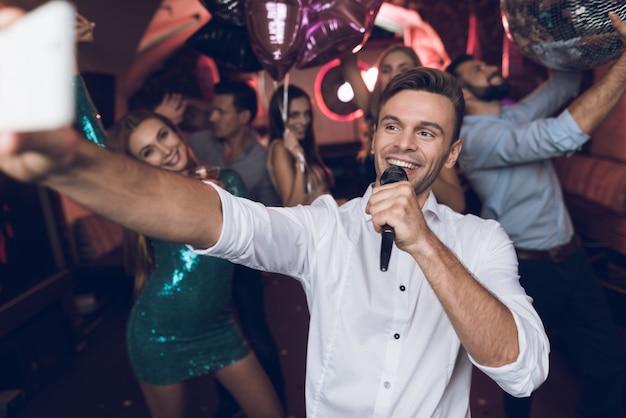 Party time guy singing in karaoke club.