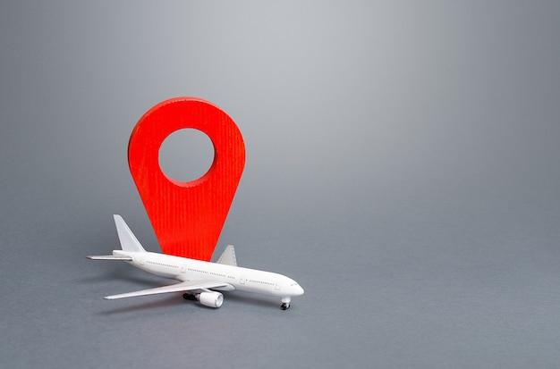 Passagiersvliegtuig en rode locatie-indicator.