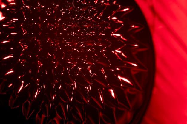 Passie rode kleuren van ferromagnetische vloeistof
