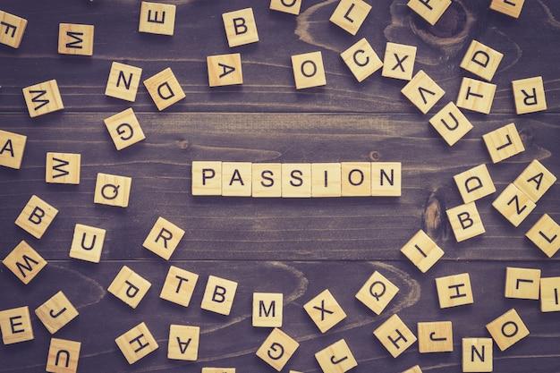 Passie woord hout blok op tafel voor business concept.