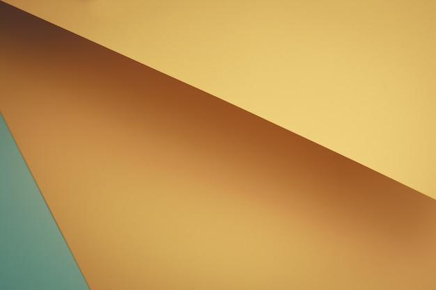 Pastel geel en blauw plat lag achtergrond met scherpe lagen en schaduwen met kopie ruimte
