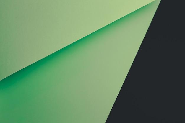 Pastel groen en zwart plat lag achtergrond met scherpe lagen en schaduwen met kopie ruimte
