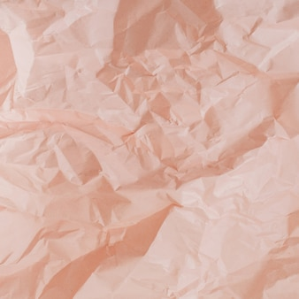 Pastel peachy verfrommeld papier textuur
