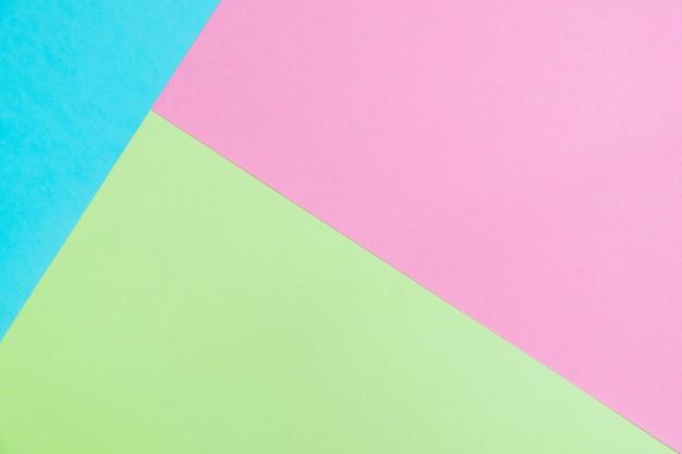 Pastelkleur papier plat lag bovenaanzicht, achtergrondstructuur