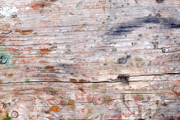 Pastelkleurhout houten met de muurachtergrond van de planktextuur
