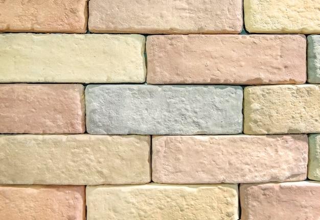Pastelkleurige bakstenen muur gestructureerd behang