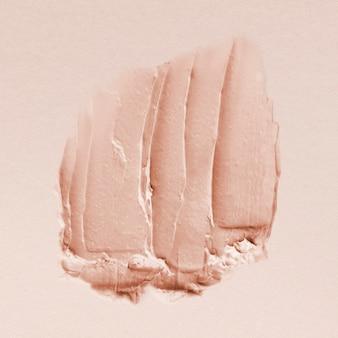 Pastelroze crème uitstrijktextuur