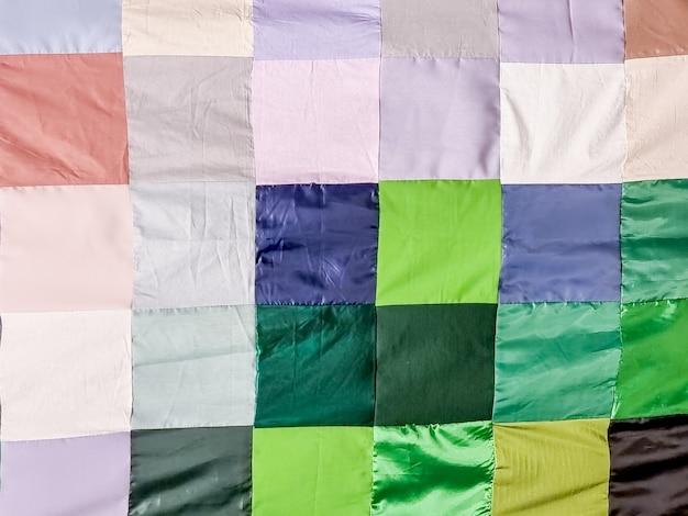 Patchwork quilt basispatroon vierkant deel van patchwork quilt als achtergrond bloemenprint kleur deken in stijl patchwork handgemaakt