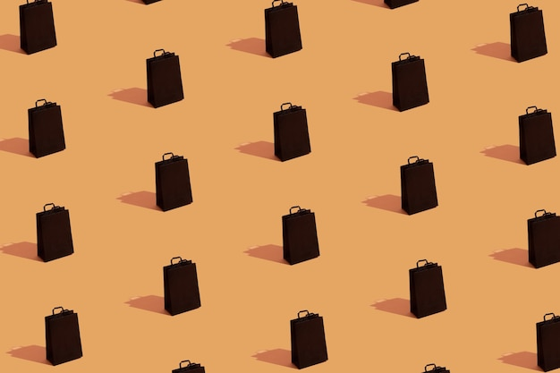 Patroon met zwarte boodschappentassen verkoop op oranje achtergrond