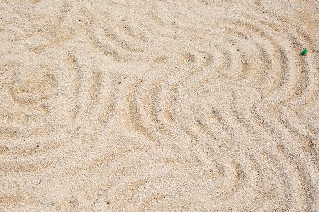 Patroon op het gele zand.